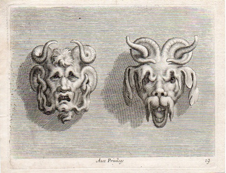 Pair of grotesque faces