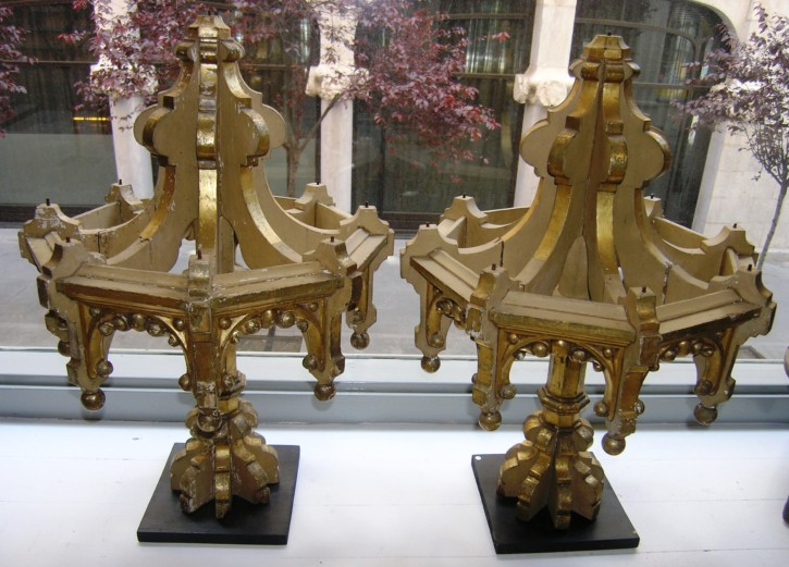 Pair of carved gilt tops