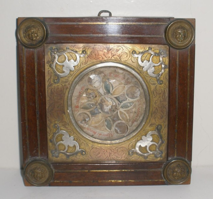 Reliquary with antique relics on compass dial
