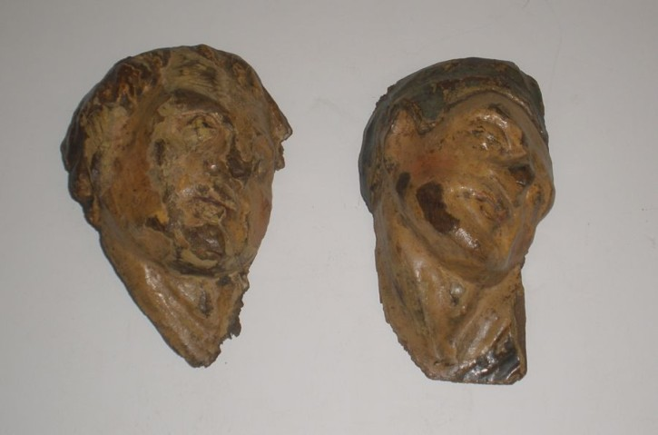 Pair of grotesque heads