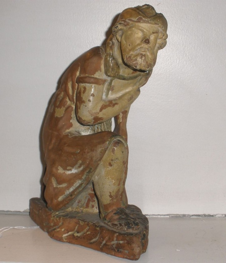 Figure of a character offering
