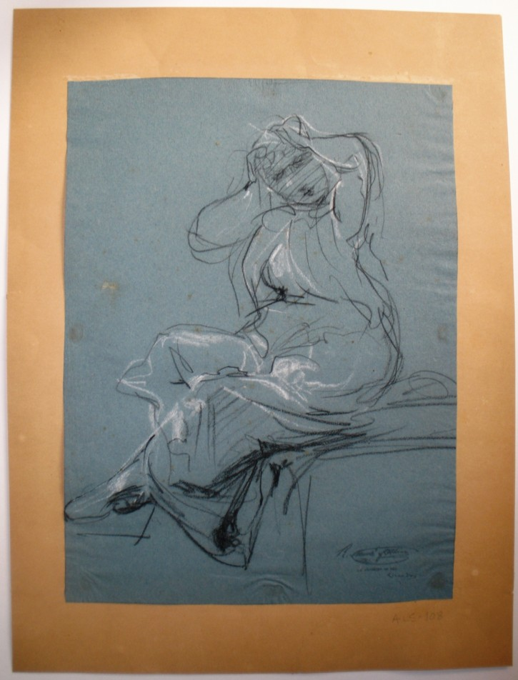 Sitting woman with hands on the head