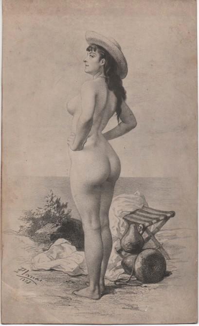 Mujer desnuda con sombrero en la playa